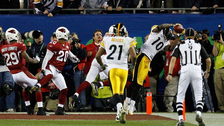 Santonio Holmes clings on for the game-winning touchdown as the Pittsburgh Steelers win a record sixth Super Bowl