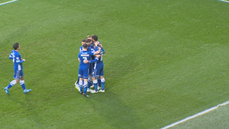 Sean Morrison: Mobbed by Cardiff team-mates after decisive goal against Fulham