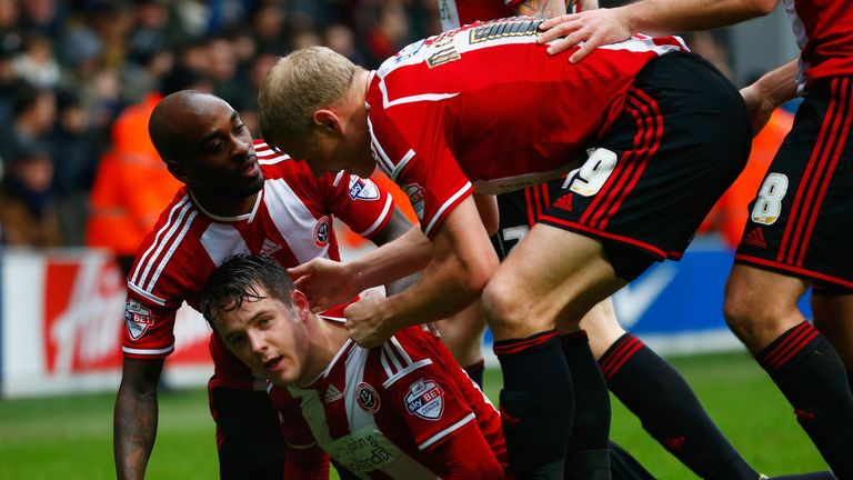 McNulty: Mobbed by team-mates