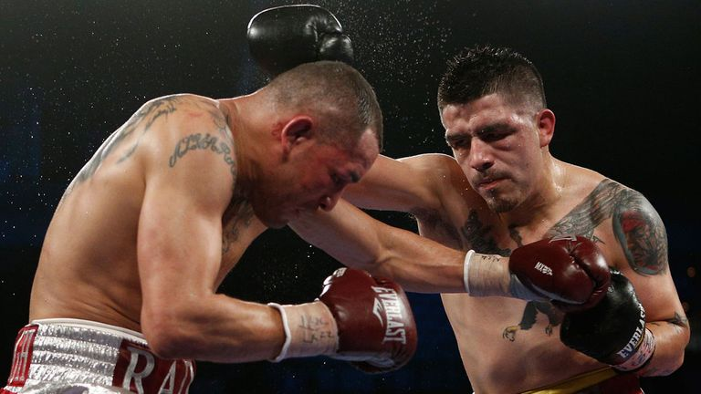 Brandon Rios lands a right hand on Mike Alvarado in their second bout