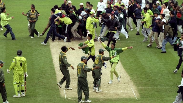 Bangladesh fans storm the pitch after their shock win over Pakistan.