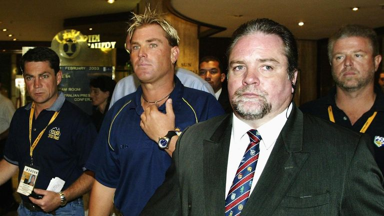 Warne prepares to face the media after his ban.