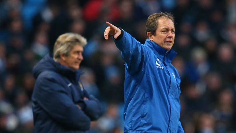 Wednesday boss Stuart Gray gestures to his players