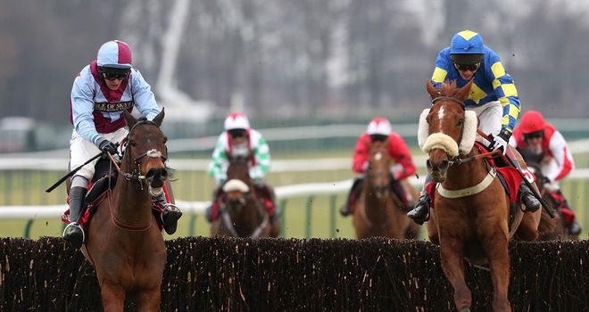 Lie Forrit (left) and Harry The Viking take the final fence together in the Betfred Grand National Trial at Haydock Park.