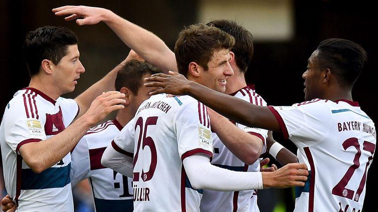 Robert Lewandowski celebrates with team mates after scoring his teams first goal