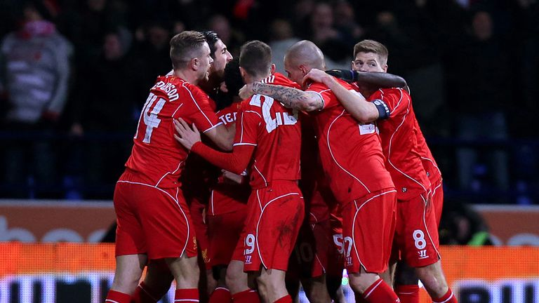 Philippe Coutinho: Is mobbed after scoring Liverpool's late winner