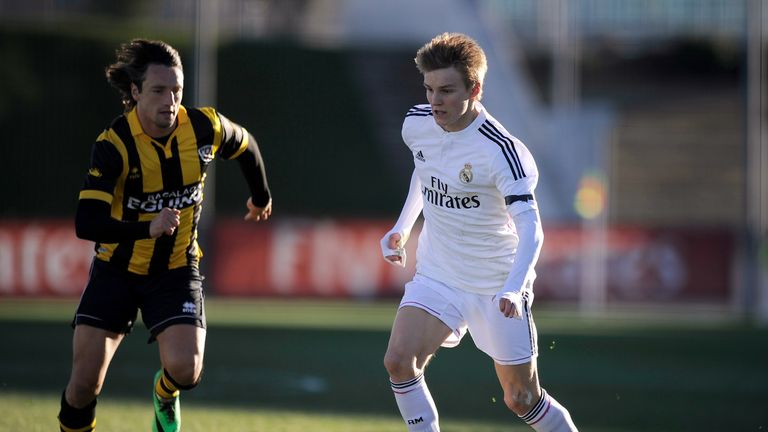 Odegaard (right) has made just one senior appearance at Real Madrid, and that was under Carlo Ancelotti