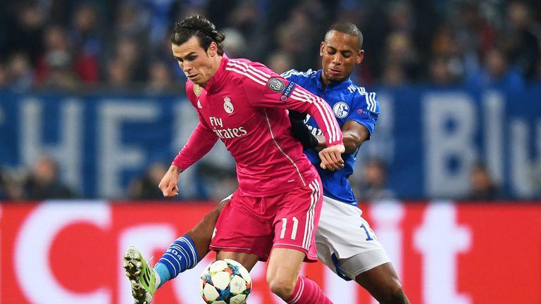 Gareth Bale is challenged by Schalke's Dennis Aogo