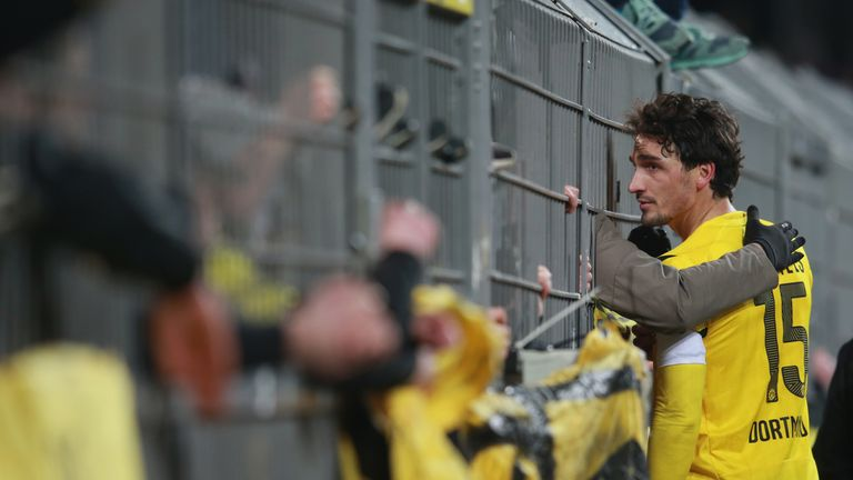 Mats Hummels of Dortmund talks to their supporters after defeat to Augsburg