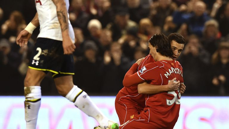 Liverpool's Lazar Markovic is congratulated after scoring the opening