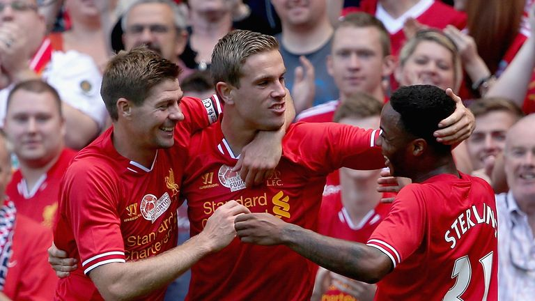 Steven Gerrard, Jordan Henderson and Raheem Sterling celebrate