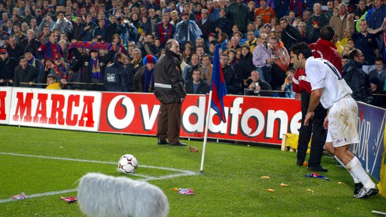 Figo is pelted with missiles as he attempts to take a corner at the Nou Camp