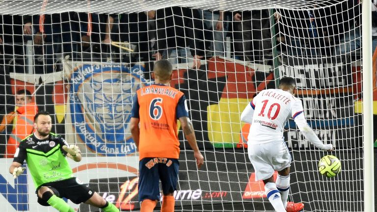 Alexandre Lacazette (right) scores a penalty against Montpellier in Ligue 1