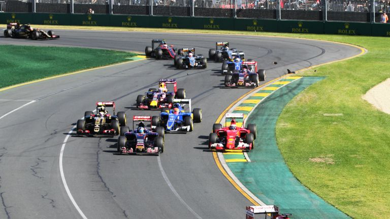 Early incident: Sebastian Vettel and Kimi Raikkonen touched at the first corner