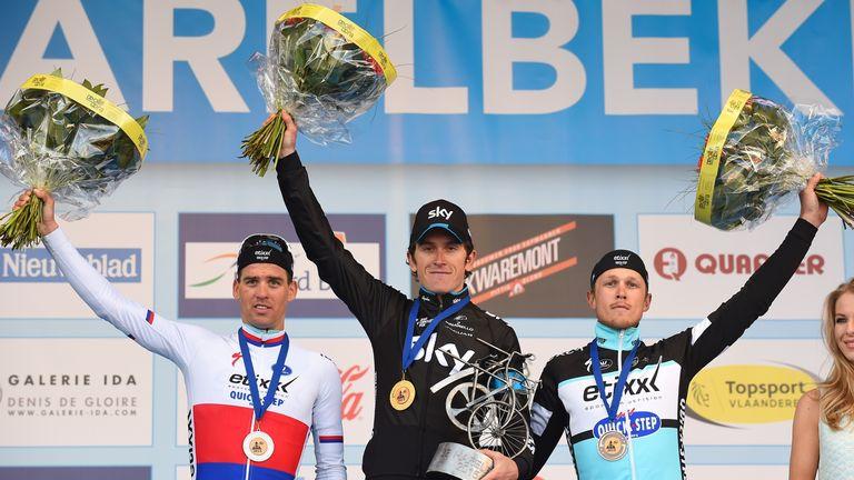 Thomas celebrates with Zdenek Stybar, left, and Matteo Trentin