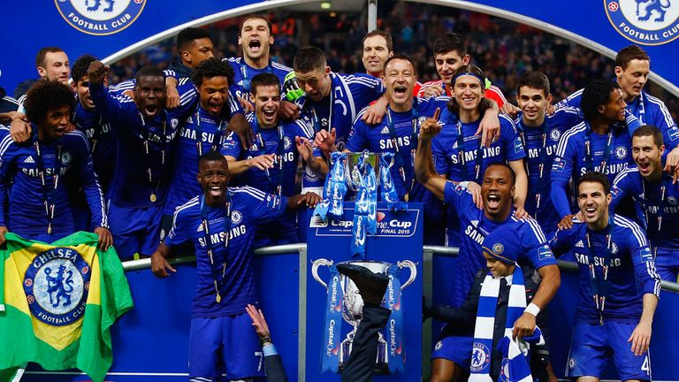 Jose Mourinho and Chelsea celebrate with the Capital One Cup