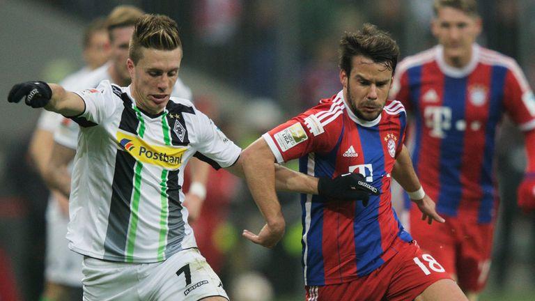 Juan Bernat of Bayern Munich challenges Borussia Moenchengladbach's Patrick Hermann