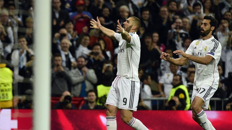 Karim Benzema celebrates on an edgy night for Real