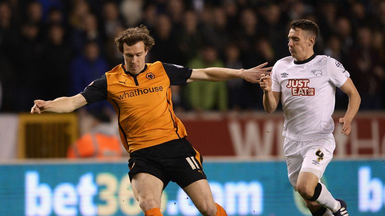 Kevin McDonald (left) battles with Craig Bryson of Derny