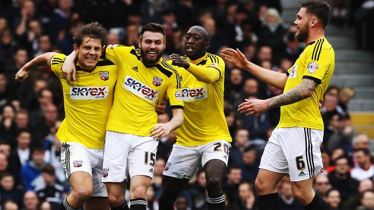 Stuart Dallas (2nd left) of Brentford celebates with team mates after opening the scoring against Fulham