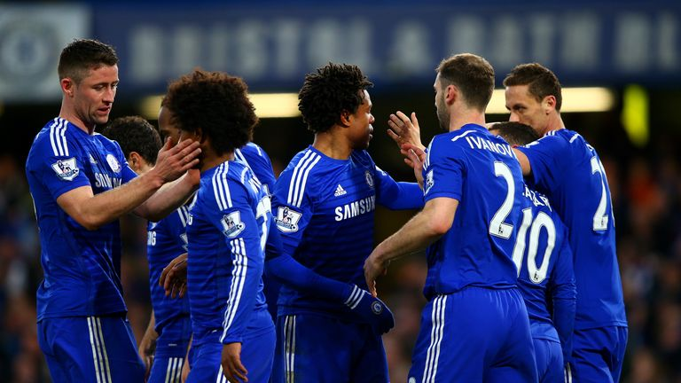 Loic Remy celebrates with his team-mates after scoring Chelsea's winner