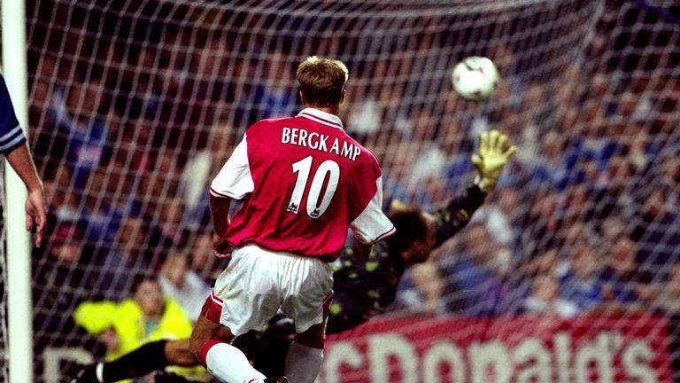 Dennis Bergkamp of Arsenal beats Kasey Keller in the Leicester City goal to complete his hat-trick in August 1997