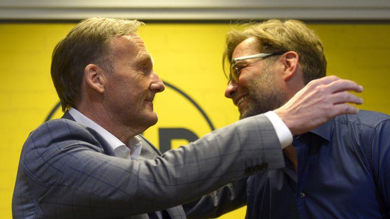 Jurgen Klopp (right) is hugged by Dortmund's CEO Hans-Joachim Watzke