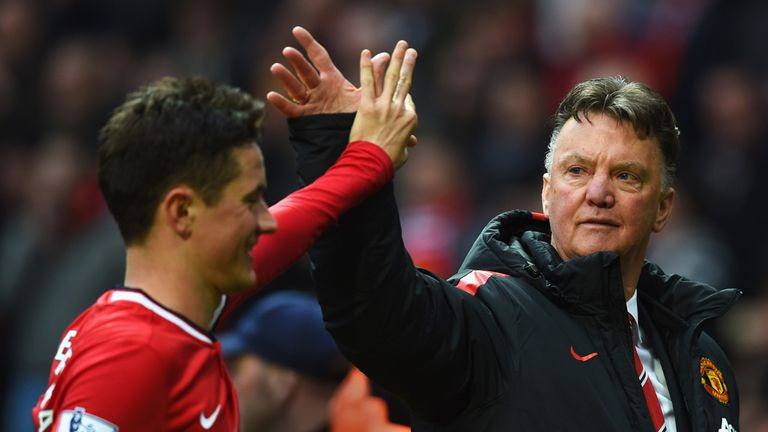 Van Gaal celebrates with Ander Herrera after the win over City