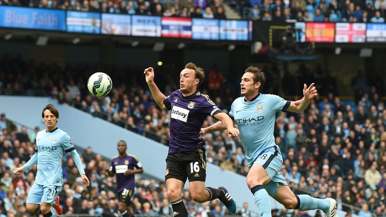 Manchester City's Frank Lampard battles with Mark Noble