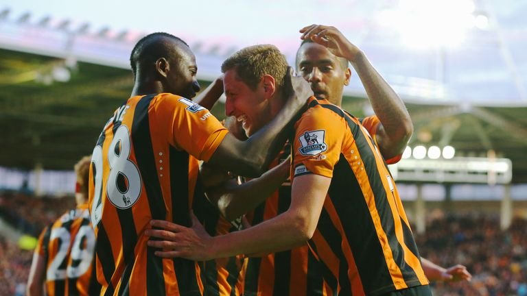 Michael Dawson: mobbed after scoring for Hull