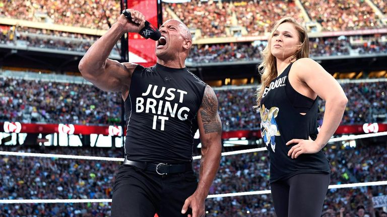 The Rock and Ronda Rousey pose after sending The Authority scarpering