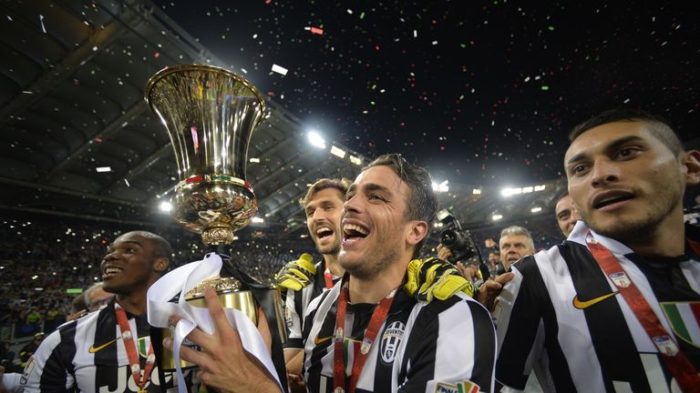 Alessandro Matri (C) celebrates with the trophy after the game