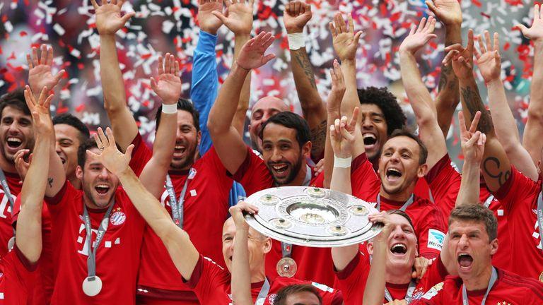Bayern Munich celebrate with the Bundesliga trophy
