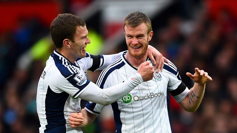 Chris Brunt (R) celebrates after his free-kick deflected in off Jonas Olsson
