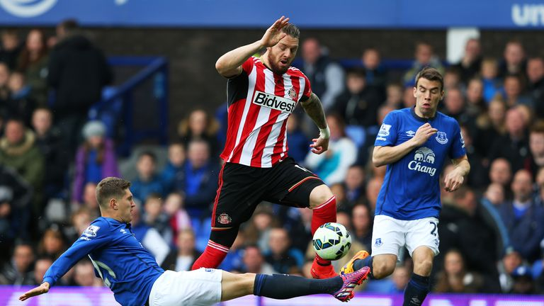 Everton's John Stones tackling Sunderland forward Connor Wickham