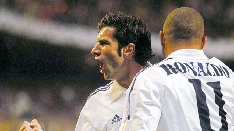 Figo celebrates with Ronaldo after scoring in the Champions League