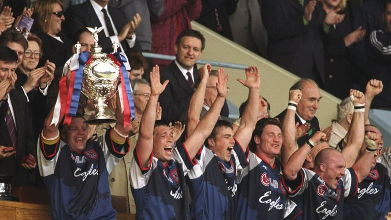 Sheffield Eagles Captain Paul Broadbent lifts the trophy aloft after their Challenge Cup win against Wigan
