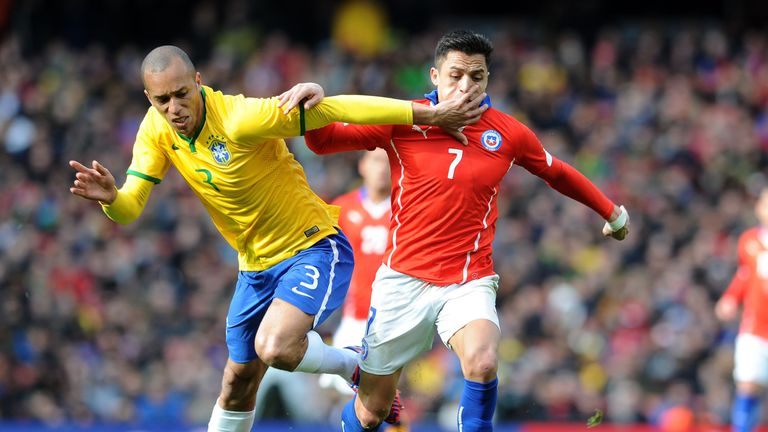 Miranda in action with Chile's Alexis Sanchez