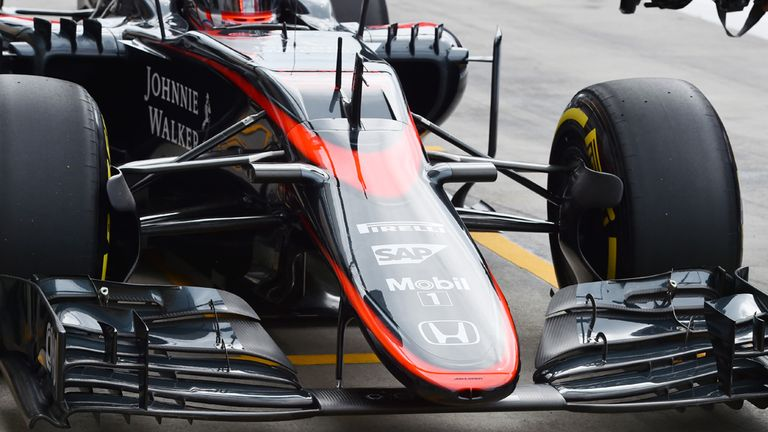 Button's McLaren remains fitted with the old 'long-form' nose