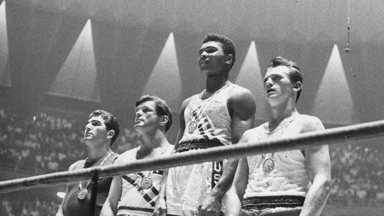 Muhammad Ali - then known as Cassius Clay - on top of the podium
