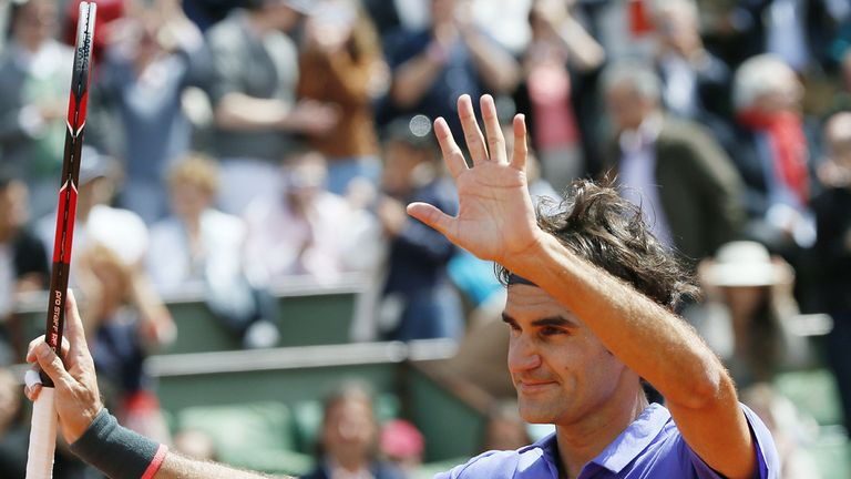 Roger Federer waves to the crowd