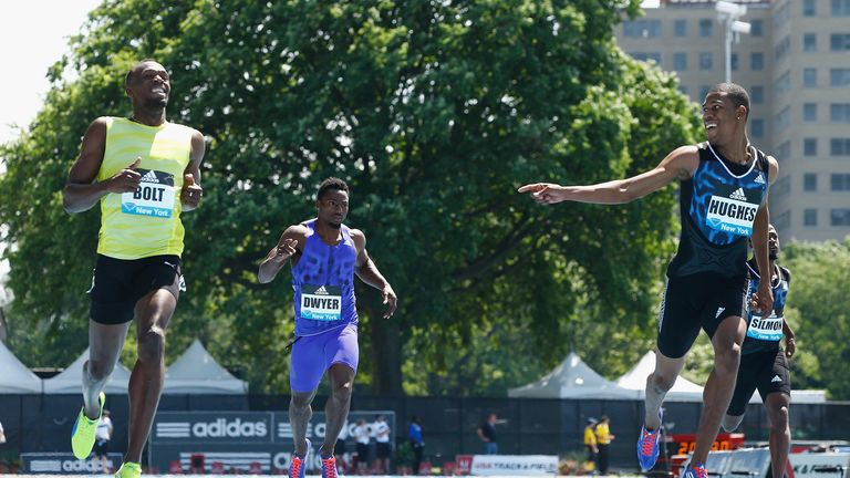 Zharnel Hughes finishes behind Usain Bolt in New York earlier in June
