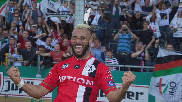 John Bostock celebrates winning promotion from the Belgian second tier with OV Leuven