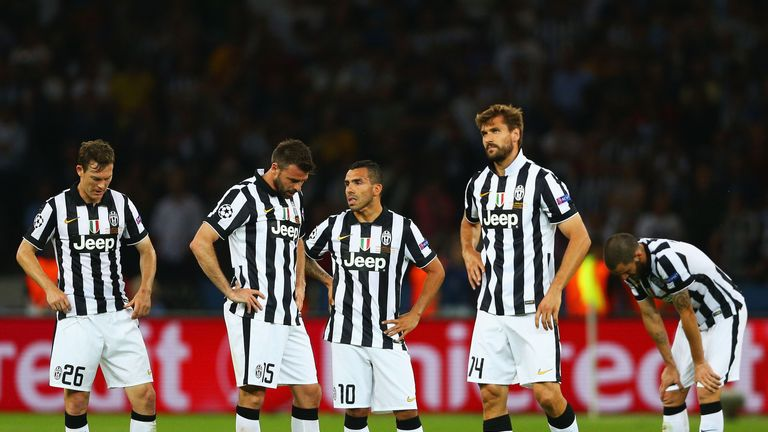 Juventus players look dejected after their defeat in the 2015 Champions League final