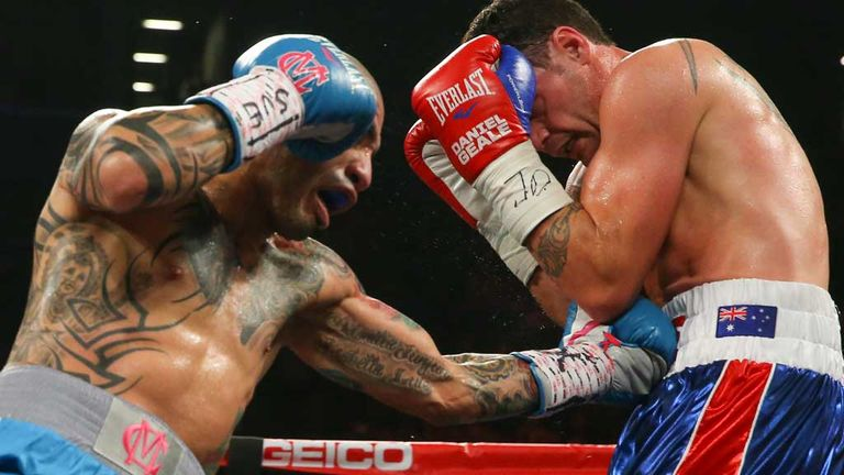 Miguel Cotto (left) lands a body shot against Daniel Geale in Brooklyn