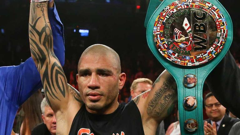 Miguel Cotto parades his WBC belt after stoppage