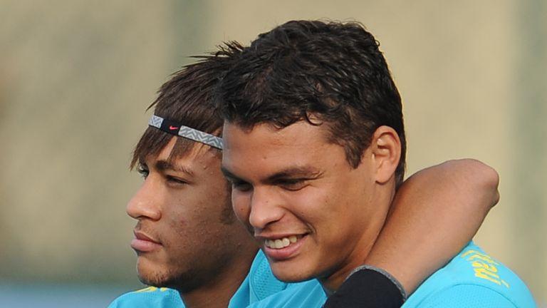 Neymar alongside his Brazil team-mate Thiago Silva (right)