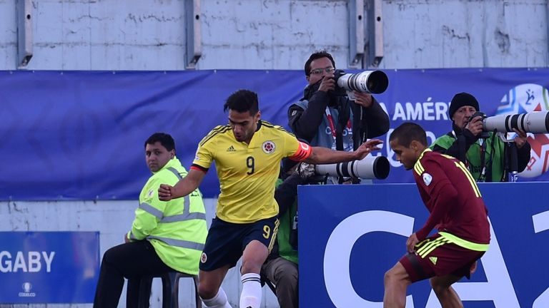 Radamel Falcao (left) vies for the ball with Venezuelan Ronald Vargas