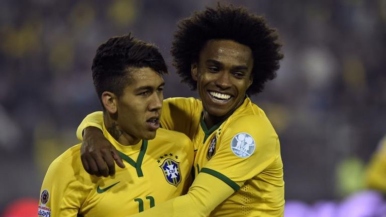 Roberto Firmino (left): Congratulated after scoring by Willian