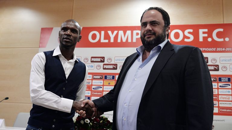 Olympikos president Vangelis Marinakis (R) shakes hands with Eric Abidal